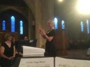 Andrea raises the baton